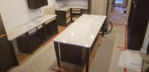 A picture of kitchen with new granite countertops